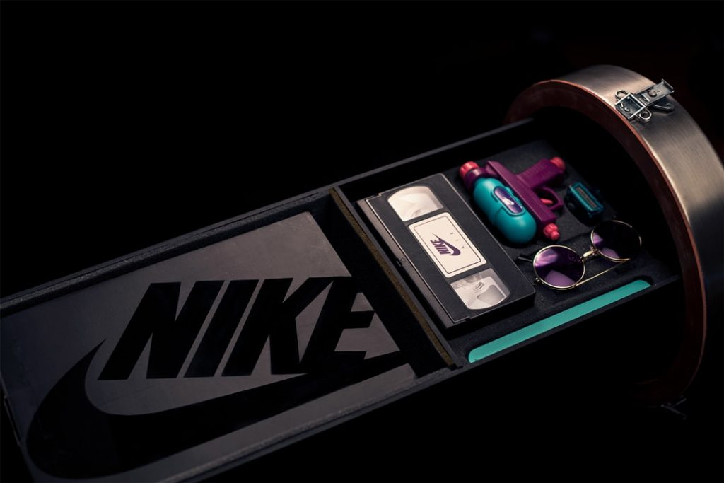 time capsule designed by Petey Petersen for Nike Time Capsule Project for the Nike Air Max shoe launch the lime capsule is open showing the Nike logo a NIKE VHS tape round purple glasses a water gun and the NIKE Air Max shoe box photographer Maria Bruun