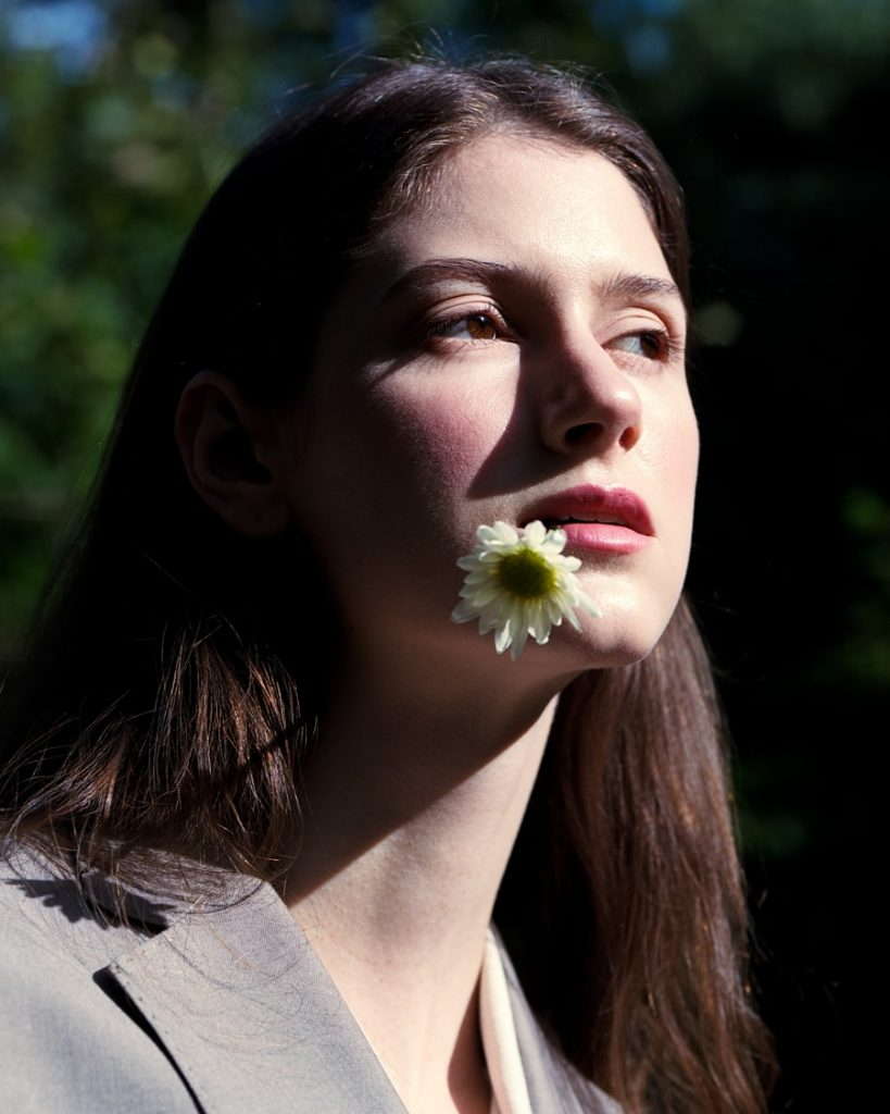 Model:Shay Davis Photographer: Maria Bruun, central park, photo captured model from profile, brown hair, high cheekbones, flower in mouth, trees, medium format photography, medium format analog photography, medium format film fine art photography, medium and large format photography, medium vs large format photography, medium format fashion photography medium format photography blog, medium format photography, photographer to hire, photographer to hire near me, photographer to follow on instagram, photographer for hire, photographer for hire New York, photographer with camera, photographer near me for photoshoot, photographer or photography, photographer or videographer, photographer or artist, photographer or photograph, photographer or photographer, photographer or filmmaker, photographer or cinematographer, photographer and videographer package