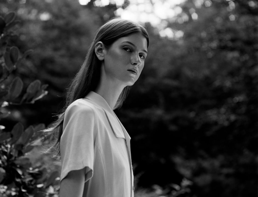 Model:Shay Davis Photographer: Maria Bruun, black and white photo, central park, photo captured model from profile, brown hair, high cheekbones, trees, medium format photography, medium format analog photography, medium format film fine art photography, medium and large format photography, medium vs large format photography, medium format fashion photography medium format photography blog, medium format black and white photography, medium format b&w photography, photographer to hire, photographer to hire near me, photographer to follow on instagram, photographer for hire, photographer for hire New York, photographer with camera, photographer near me for photoshoot, photographer or photography, photographer or videographer, photographer or artist, photographer or photograph, photographer or photographer, photographer or filmmaker, photographer or cinematographer, photographer and videographer package